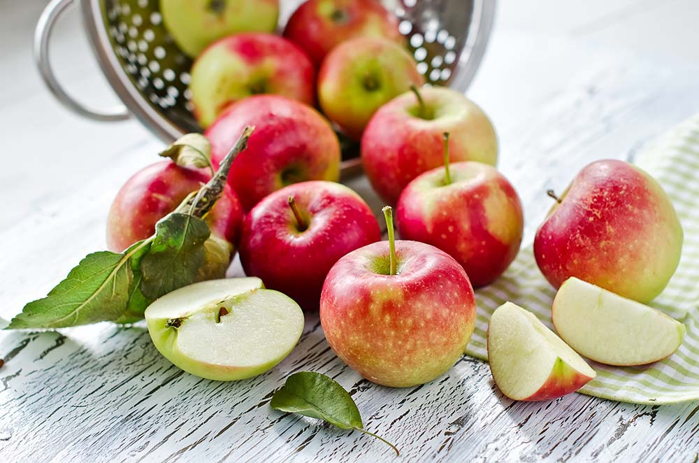 apples in a metal colander selective focus