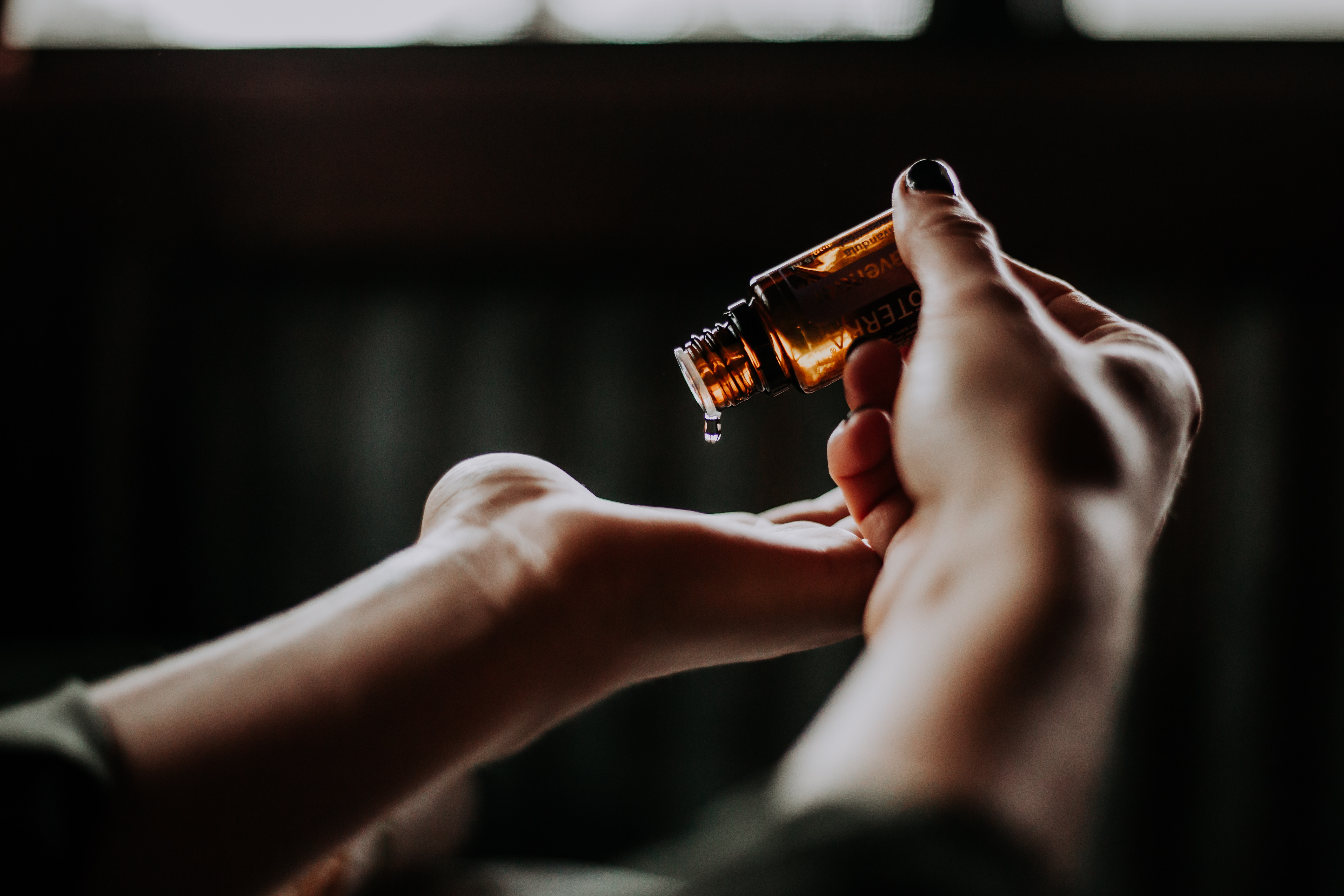 female hands holding CBD oil