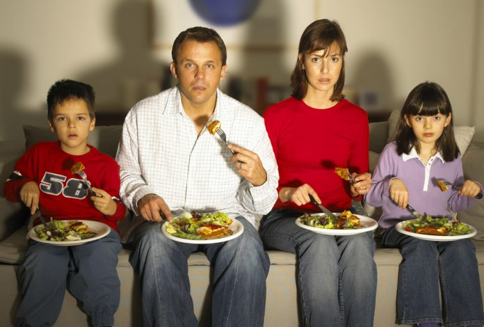 People eating a TV Dinner