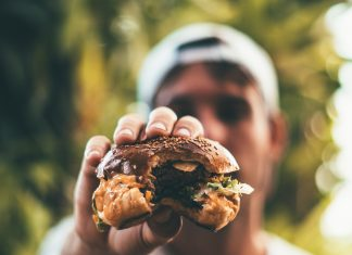 Juicy Burger with Person in Background
