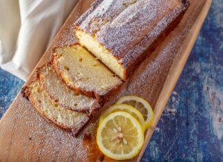 Moist lemon loaf cake on a bread board.