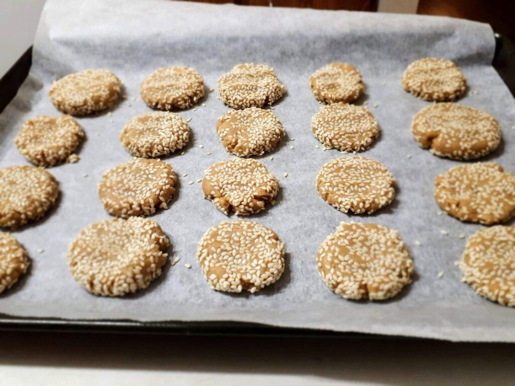 Tahini cookies on baking sheet.