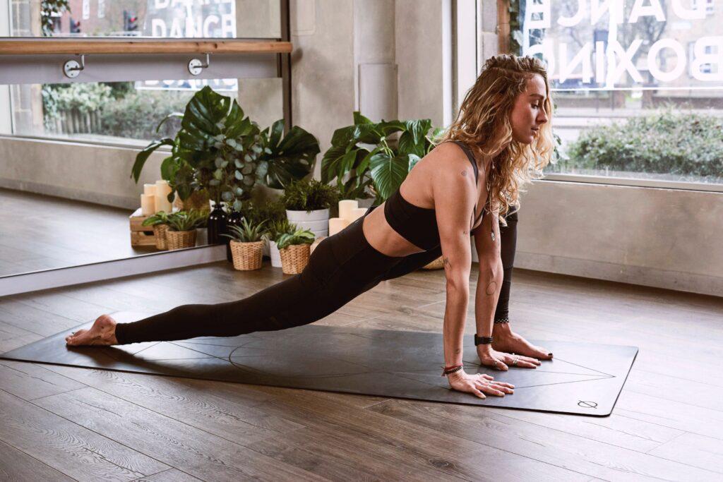 woman doing yoga in Lizard pose