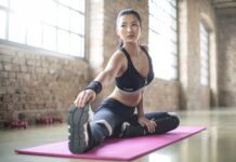 fit woman stretching on yoga mat