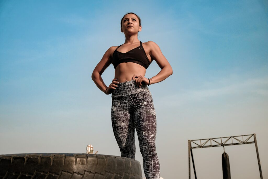 Strong woman posing after HIIT workout