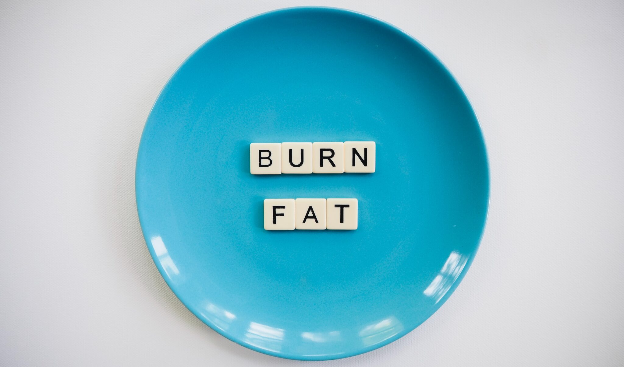 photo of a burn fat text on round blue plate 2383009